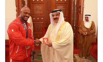 HM King honours professional bodybuilder